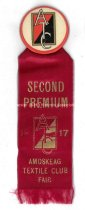 Image of Red Ribbon with Badge from the Amoskeag Textile Club Fair, 1917 - 1973.558.002