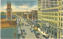 Image of Postcard, Looking North on Elm Street, Manchester, the Downtown Business District.  Amoskeag Bank Bldg. on Right; City Hall Clock on Left. - 2012.514.076