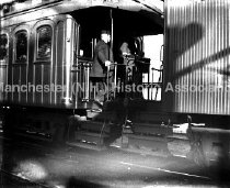 Image of People boarding railroad car - 68-010-047