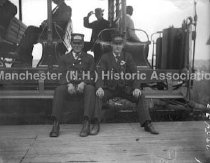 Image of Two motor men on running board of Open Tooley Car - 73-P054-002-004