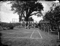 Image of Shirley Hill House, showing marked grass tennis court - MHAGN 298c