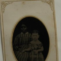 Image of 5 - African-American woman and white child