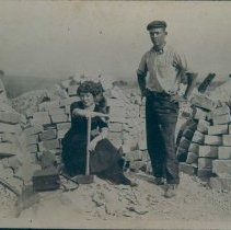 Image of Ward and Stella Spielman in East Sioux Stone Quarry R yard, n.d.