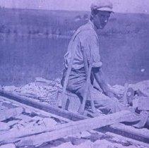 Image of Sam Morrison cutting stone, n.d.