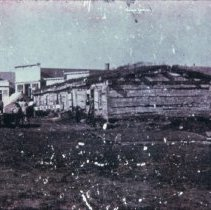Image of Old Fort Dakota barracks (Phillips Ave. and 8th looking south), ca. 1872