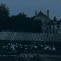 Image of Calvery Cathedral behind Sioux Falls Farmers Market, 1912