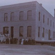 Image of Group in front of original Manchester Biscuit Company Building, n.d.