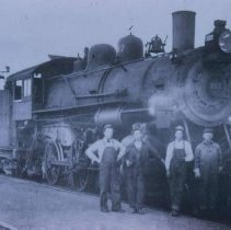 Image of Group in front of a locomotive on the Omaha Line, ca. 1930s