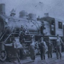 Image of Group in front of a Great Northern locomotive, ca. 1920-1925
