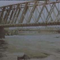 Image of Looking south at a MIlwaukee and St. Paul Railroad bridge, n.d.