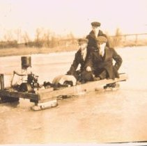 Image of Sydney, Carl, and Paul Norberg in a motorized ice boat, 1912
