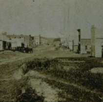 Image of Looking north on Phillips Ave. at 10th St., ca. 1875