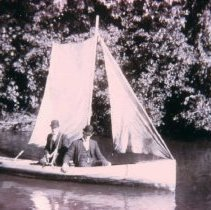 Image of Three men boating on the Sioux River, ca. 1890s
