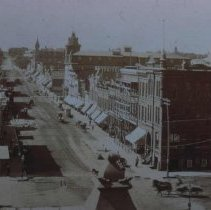 Image of Phillips Ave. (looking south from the Commercial House), ca. 1885-1889