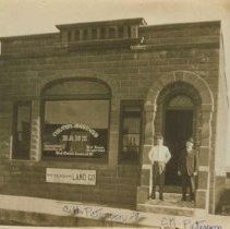 Image of C. H., C. N. Peterson in front of Colton Savings Bank in Colton, SD, n.d.