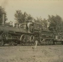 Image of Men riding South Dakota Central train (first to serve Colton, SD), 1905