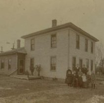 Image of John Edmund Colton and family on homestead, pre-1899