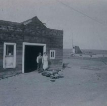 Image of Henry and Harriett Podraty at blacksmith shop in Bison, SD, October 1933