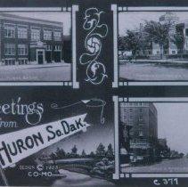 Image of City Hall, a Presbyterian church, and Dakota Avenue in Huron, SD, 1928