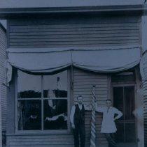 Image of Harry Putnam's Barber Shop in Hartford, SD, ca. 1900