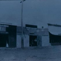 Image of H. D. Oaks Hardware and Implements (right) in Hartford, SD, ca. 1900