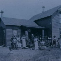 Image of People outside the Mike Dailey home in Hartford, SD, ca. 1900