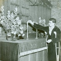 Image of Patient lighting candle in the chapel at Crile General Hospital