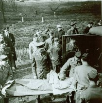 Image of Wounded soilders being loaded into ambulances at Linndale, April 17. 1944 - 2012.23.28