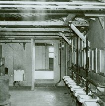 Image of Enlisted men's latrine in the barracks at Crile General Hospital - 2012.23.38
