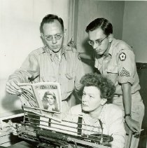 Image of Raymond Burke, Katherine Keyes, and Al Murway working on the Crile Crier - 2012.23.61