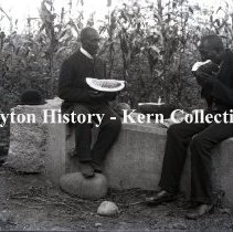 Image of K.5.9.831 - Glass - Plate negative - Fort Harrison - Two locals eating watermelon - Old John Johnson & his son Charlie Johnson - Richmond, VA - August, 1898