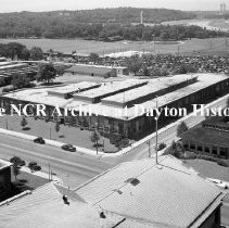 Image of NCR.1998.0584.249 - Views on Main Street - Building #20 overlooking Carillon, South Main Street from the roof of Building #10, Dayton, OH July 11, 1949 Nice view of Building #20 and area South West of the Factory - Carillon Tower clearly in view, along with the pool at Old River, and the DP&L power plant.