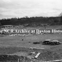 Image of NCR.1998.0603.280 - Old River/Shaw Field - Shaw Field Under Construction - Concrete Form for Swimming Pool - Factory In Background, Dayton, OH November 7, 1938