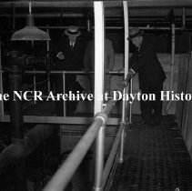 Image of NCR.1998.0603.514 - Old River - The First Sunday - Men Inspecting Machinery, Dayton, OH June 4, 1939