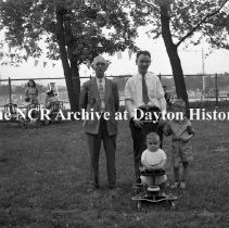 Image of NCR.1998.0603.801 - Old River - Memorial Day - Two Men Posing With Children - Family Portrait, Dayton, OH May 30, 1941