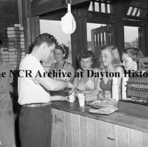 Image of NCR.1998.0604.1172 - Old River - Fourth Of July At Old River - Four Young Ladies Being Served At The Refreshment Stand, July 4, 1947