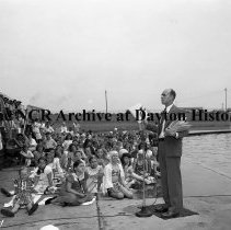 Image of NCR.1998.0604.1397 - Old River - Swimming Class Graduation - Man Addressing The Children And Families In The Pool Bleachers, July 26, 1947