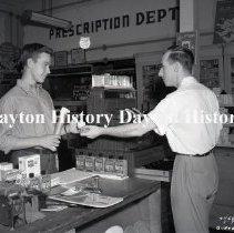 Image of NCR.1998.0826.202 - Film Negative - Drug Stores - Pulaski Heights Pharmacy - Cashier - Little Rock, AR - July 9, 1951