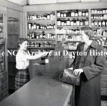 Image of NCR.1998.0827.165 - Film Negative - Drug Stores - Ridgewood Drug Co., Cashier, Ridgewood, NJ, February 14, 1951