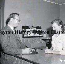 Image of NCR.1998.0831.064 - Film Negative - Hotels - University Motel - Front Desk Clerk w/ Customer - Augusta, GA - February 6, 1959