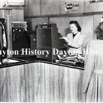 Image of NCR.1998.0832.178 - Film Negative - Laundry - Revo's Master Cleaners - Cashier - Wichita, KS - March 23, 1953