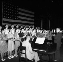 Image of NCR.1998.0914.334 - War Bonds - 10% War Bond Drive In The Auditorium - View Showing A Choir On Stage, Dayton, OH July 17, 1942