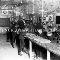 Image of NCR.1998.CD12.27 - Glass negative - Boys woodcarving class - NCR House, Dayton, OH Dec. 18, 1906 Interior