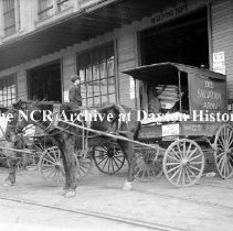 Image of NCR.1998.CD21.17 - Glass negative - Flood -  Salvation Army wagon at NCR, Dayton, OH 1913