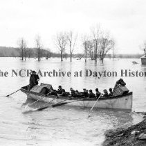 Image of NCR.1998.CD21.19 - Glass negative - Flood -Navy rescue boat helps in relief , Dayton, OH 1913