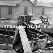Image of NCR.1998.CD21.20 - Glass negative - Flood -Pianos ruined in flood, Dayton, OH 1913