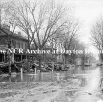 Image of NCR.1998.CD21.21 - Glass negative - Flood -Debris against houses-Monument Ave., Dayton, OH 1913