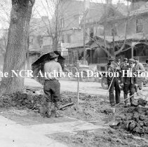 Image of NCR.1998.CD21.24 - Glass negative - Flood -Man with umbrella, Dayton, OH 1913