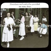 Image of NCR- Overshoes & umbrellas provided on rainy days, Dayton, OH