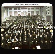 Image of NCR.1998.CD23.33 - Lantern-slides -  NCR - Noon hour entertainment, Dayton, OH Taken at NCR Schoolhouse Interior
